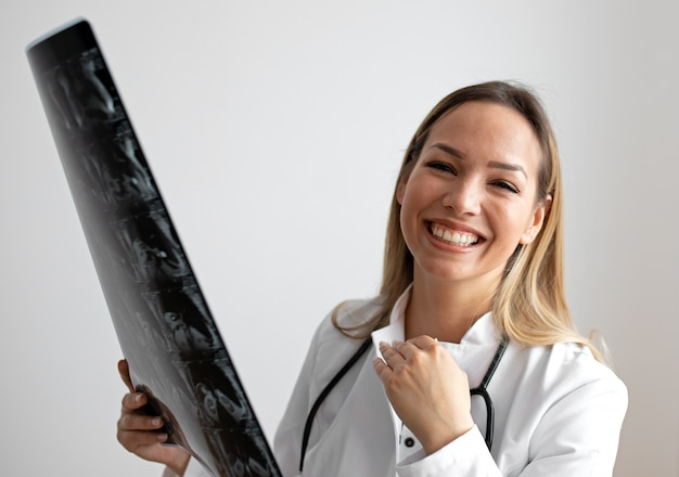 Female doctor looking at the x-ray picture