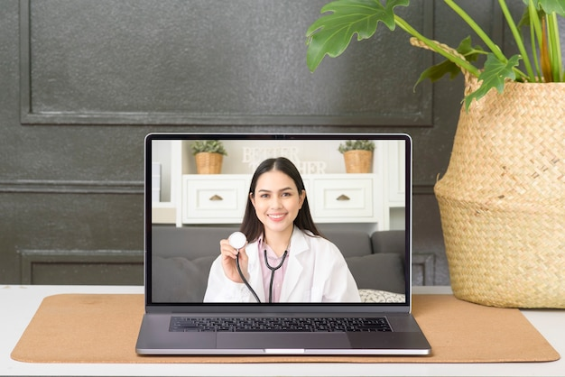 Female doctor making video call on social network with patient consulting about health problems.