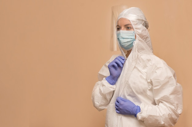 Female doctor in a protective suit to combat the coronavirus pandemic