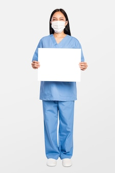 Female doctor showing a blank sign board
