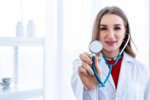 Female doctor showing stethoscope