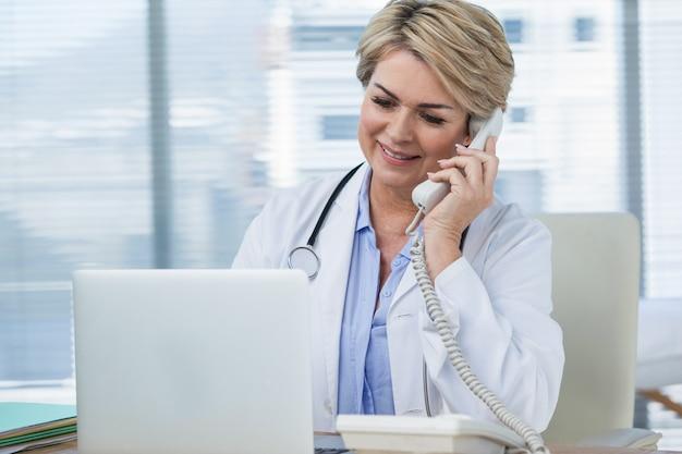 Female doctor talking on telephone