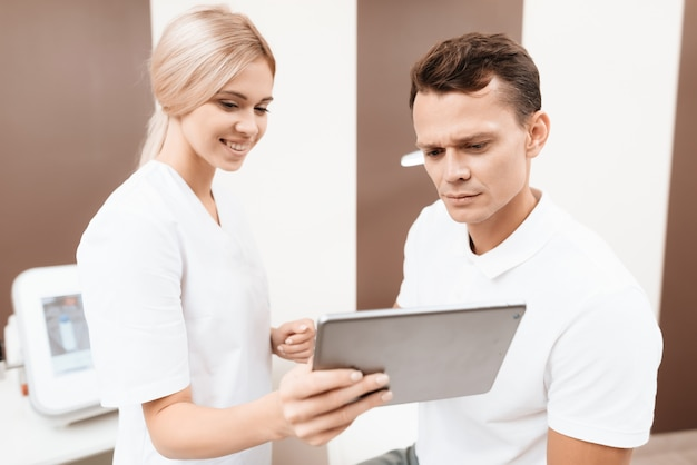 Female doctor talks to man. spa medicine concept.