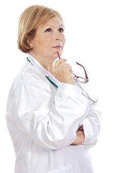 Female doctor thinking a over white background