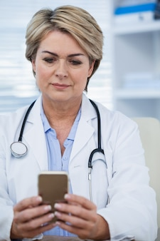 Female doctor using mobile phone
