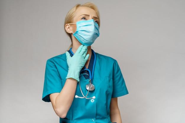 防護マスクとラテックス手袋首の病気を着ている女性医師