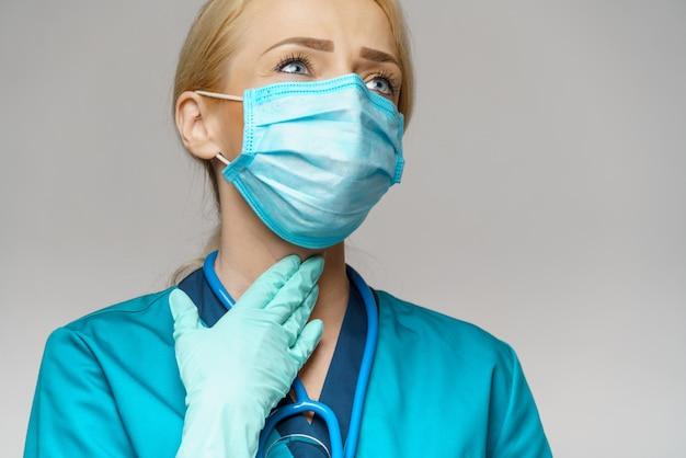 防護マスクとラテックス手袋首の病気を着ている女性医師 Premium写真
