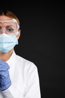 Female doctor wearing protective medical equipment