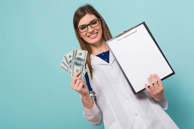 Female doctor with fan of money and clipboard