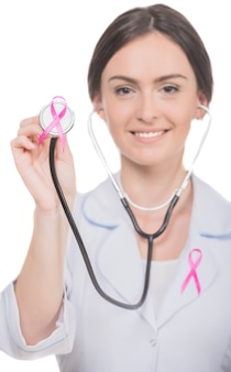 Female doctor with pink breast cancer awareness ribbon.