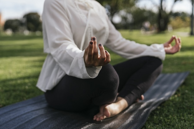 Female doing yoga outdoor at a park