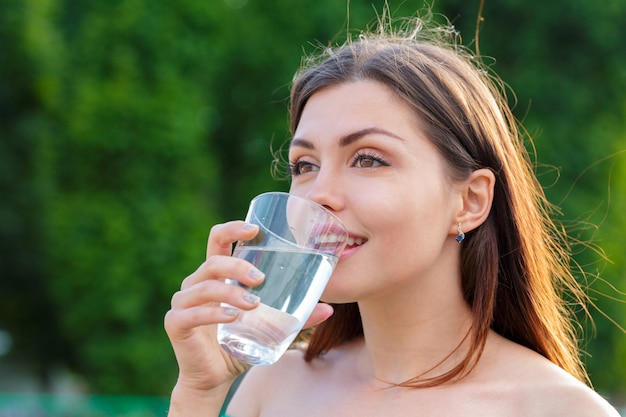 Female drinking from a glass of water. health care concept photo