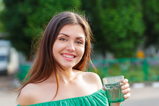 Female drinking from a glass of water health care concept photo