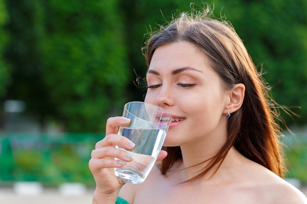 Female drinking from a glass of water. health care concept