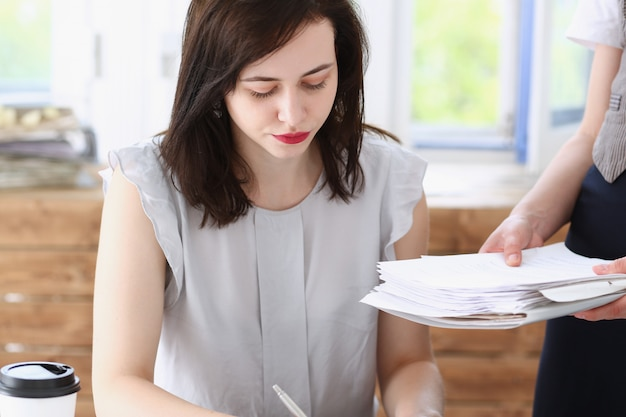 Female employee showing pack of documents