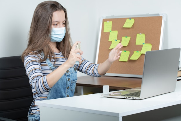 Female employee working in isolated conditions and using preventive actions