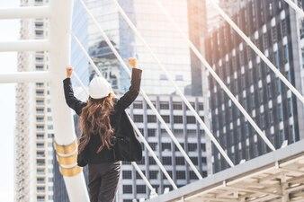 Female engineer in winning pose