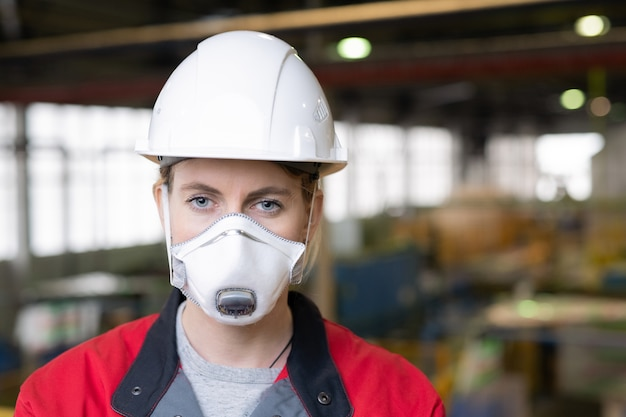 Female engineer in protective mask