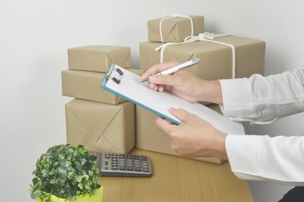 Female entrepreneur holding clipboard and check order