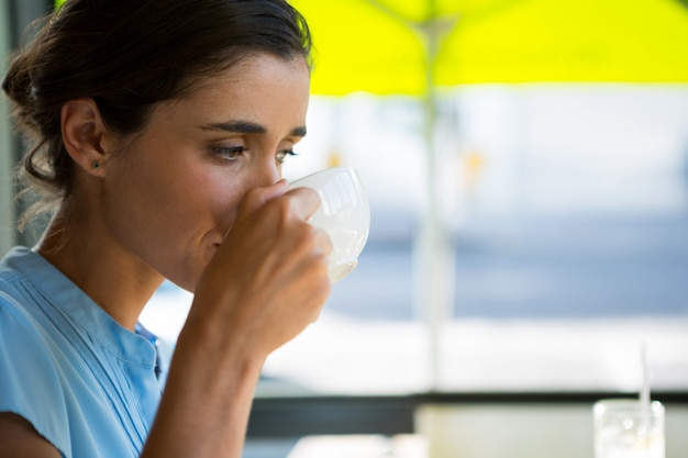 Female executive drinking coffee