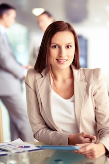 Female executive working in a busy office