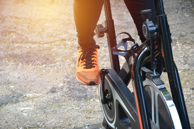 Female exercising on bicycle for exercising and healthy lifestyle concept.