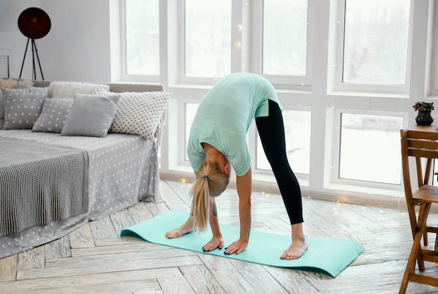 Female exercising on mat