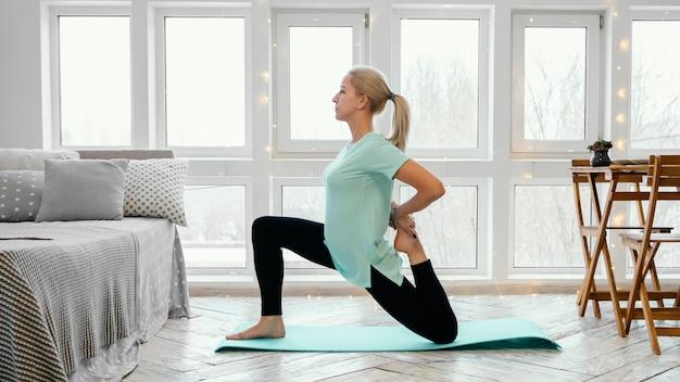Female exercising on mat