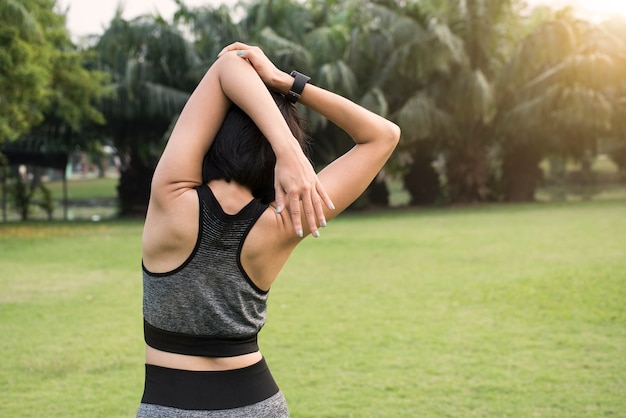 Female exercising stretch her arms relax to muscle.