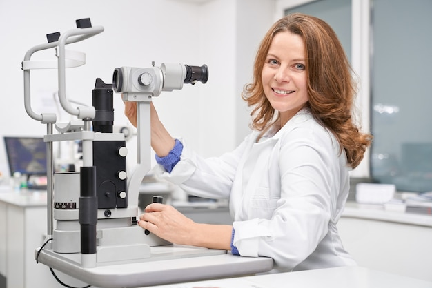 Female eye doctor working in clinic and checking eyesight