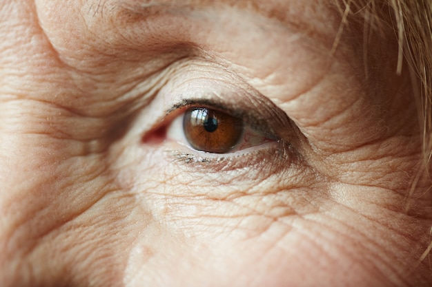 Female eye of elderly woman