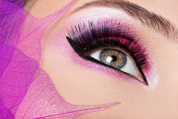Female eye with beautiful fashion bright pink makeup