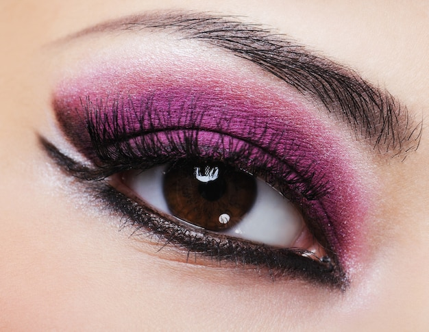 Female eye with purple bright make-up