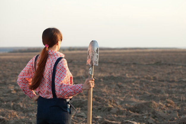 Female farmer  in plowed field