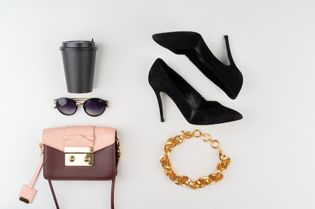 Female fashion accessories on white background, view from above