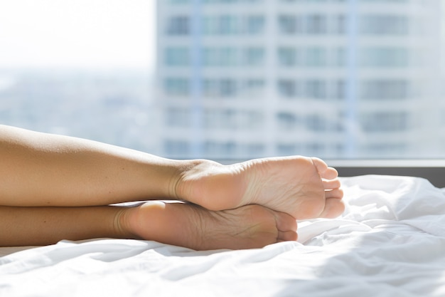 Female feet on the bed