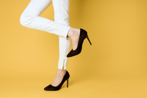 Female feet black shoes fashion clothing studio yellow.