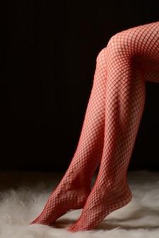 Female feet in red stockings
