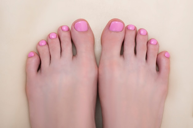 Female feet with a pink pedicure