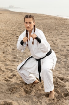 Female fighter exercising karate