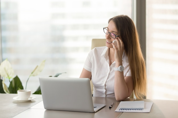 Female financial adviser consults clients by phone