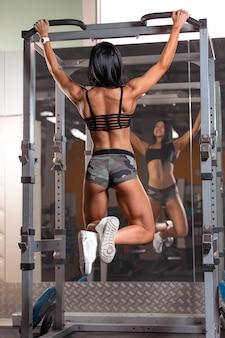 Female fitness model on bar