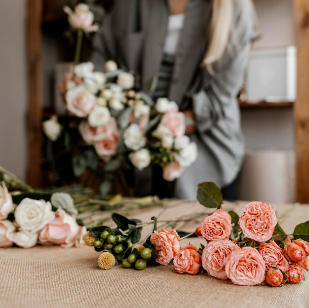 Female florist making a beautiful floral arrangement