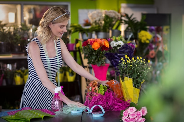 Female florist preparing flower bouquet