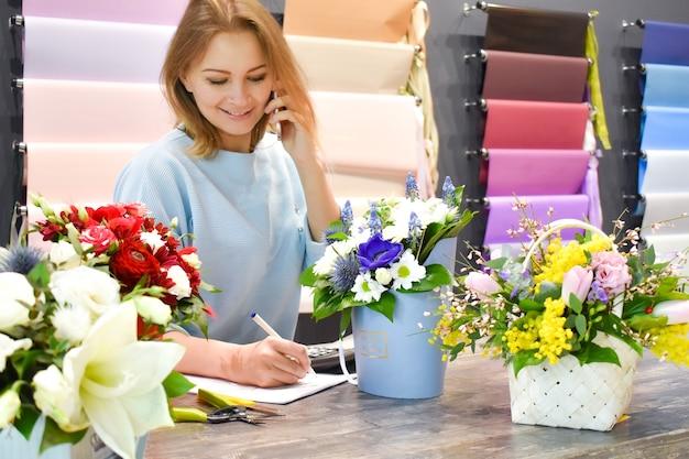 Female florist taking an order