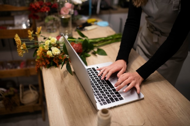 Female florist using a laptop at work
