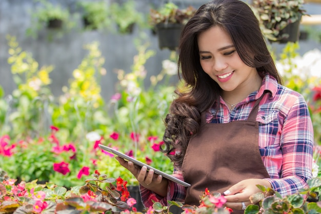 Female florist using tablet