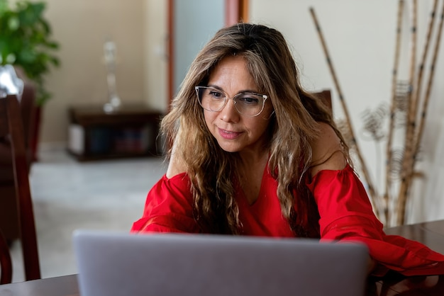 Female freelancer using laptop at home