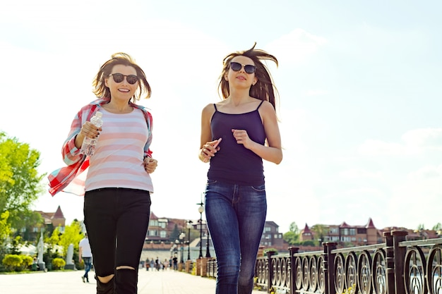 Female friends exercising and walking