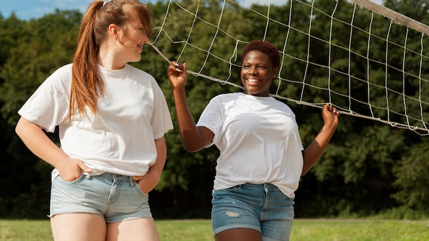 Female friends outdoors with net